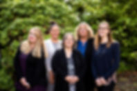 All Staff Photo. From left to right, Amber Deutsch Patient Care Coordinator, Kaja Kuenzi Patient Care Coordinator, Dr. Danette Jackson Doctor of Audiology, Kath Bussard Office Manager, Dr. Larissa Anderson Doctor of Audiology.