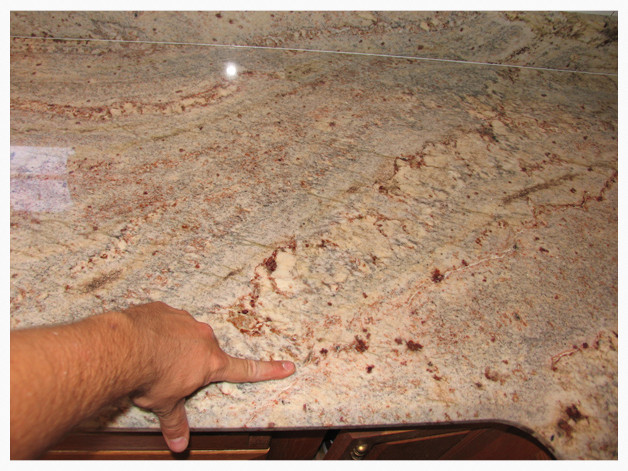 Seams in a granite countertop.