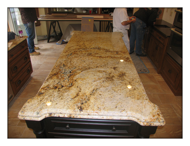Colonial gold granite with an ogee over bullnose edge