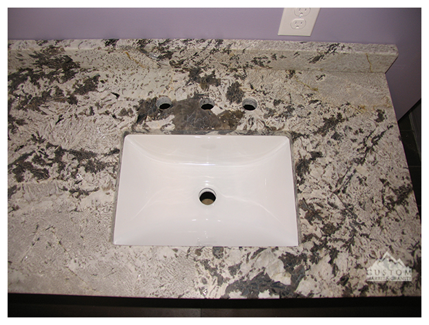 Aspen White leather granite bath counters