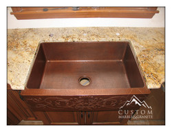 Colonial Gold granite with copper apron sink