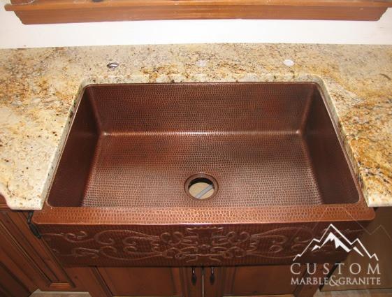 Colonial Gold granite with copper apron