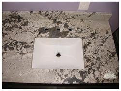 Aspen White leather granite bath counters
