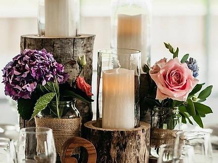 Woodan logs with silk flowers to match arwen