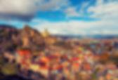 georgia-tbilisi-buildings-clouds-sky-cit