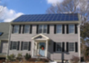 Solar_panels_on_house_roof_winter_view.j