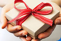 Hands holding a Red Ribbon Gift Box