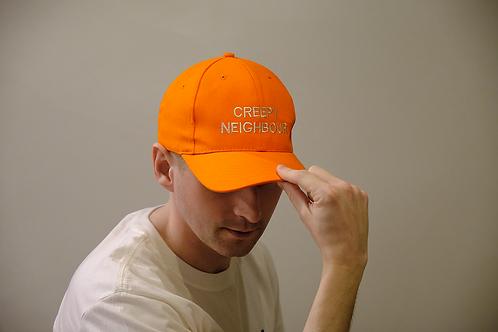 Orange cap - CREEPY NEIGHBOUR