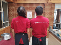 Tag line on the back of staff uniform.