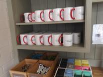 'Ash' mug at coffee station.