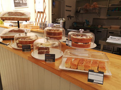 Cakes displayed along with cake tags.