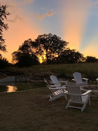 Firepit at sunset in the Meadow at The Alexander at Creek Road