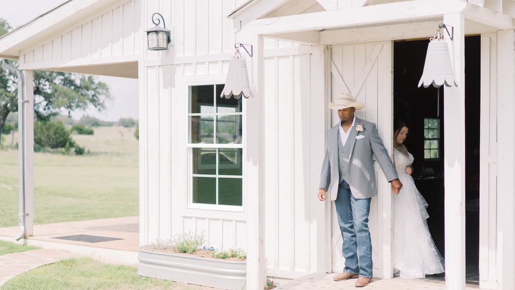 Photo by Holly Marie  of First Touch at WindSong Barn in Dripping Springs at The Alexander at Creek Road Wedding Venue