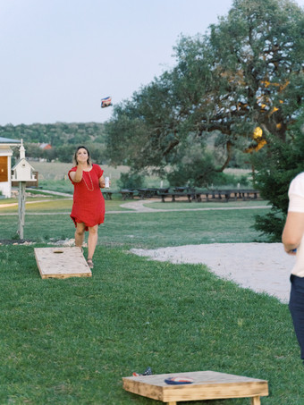 Family Reunion Lawn Games by Holly Marie Photography at The Alexander at Creek Road Lodging and Event Venue near San Antonio
