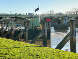 Richmond Lock. The sluice gates across the river are only raised for a few hours a day based on time of high tide