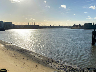 Looking upstream towards Greenwich. 2 domes of the Old Naval College & masts of Cutty Sark visible