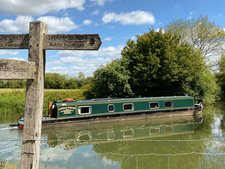 Narrowboat about to navigate another bend