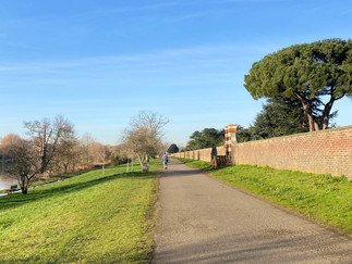 The path now continues alongside Hampton Court Park. Earlier clouds have now gone