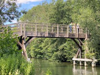 Wooden bridge across to the island at Hurley Lock