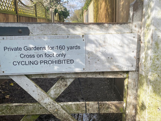 Path cuts through peoples' gardens