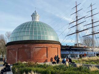 Cutty Sark and the dome of the entrance/exit to the Greenwich Foot Tunnel linking Cutty Sark to Island Gardens