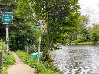 After 1 mile the path leaves the river at this hotel & crosses the railway