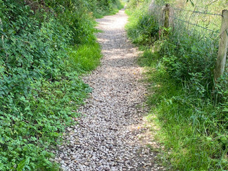 Narrow pathway between 2 lakes as the path heads for Ashton Keynes village