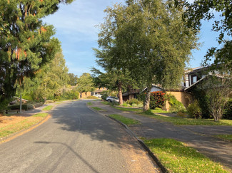 Path continues through residential streets of Purley On Thames