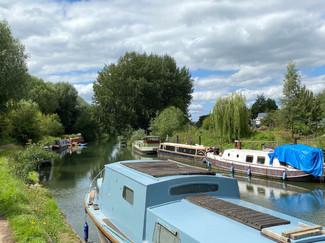 Numerous parked up narrowboats