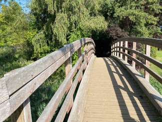 The wooden bridge at the end of the weir takes you back to the north bank of the river