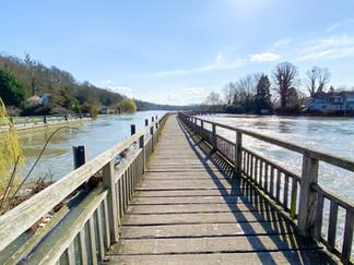 Wooden bridge back to the riverside again