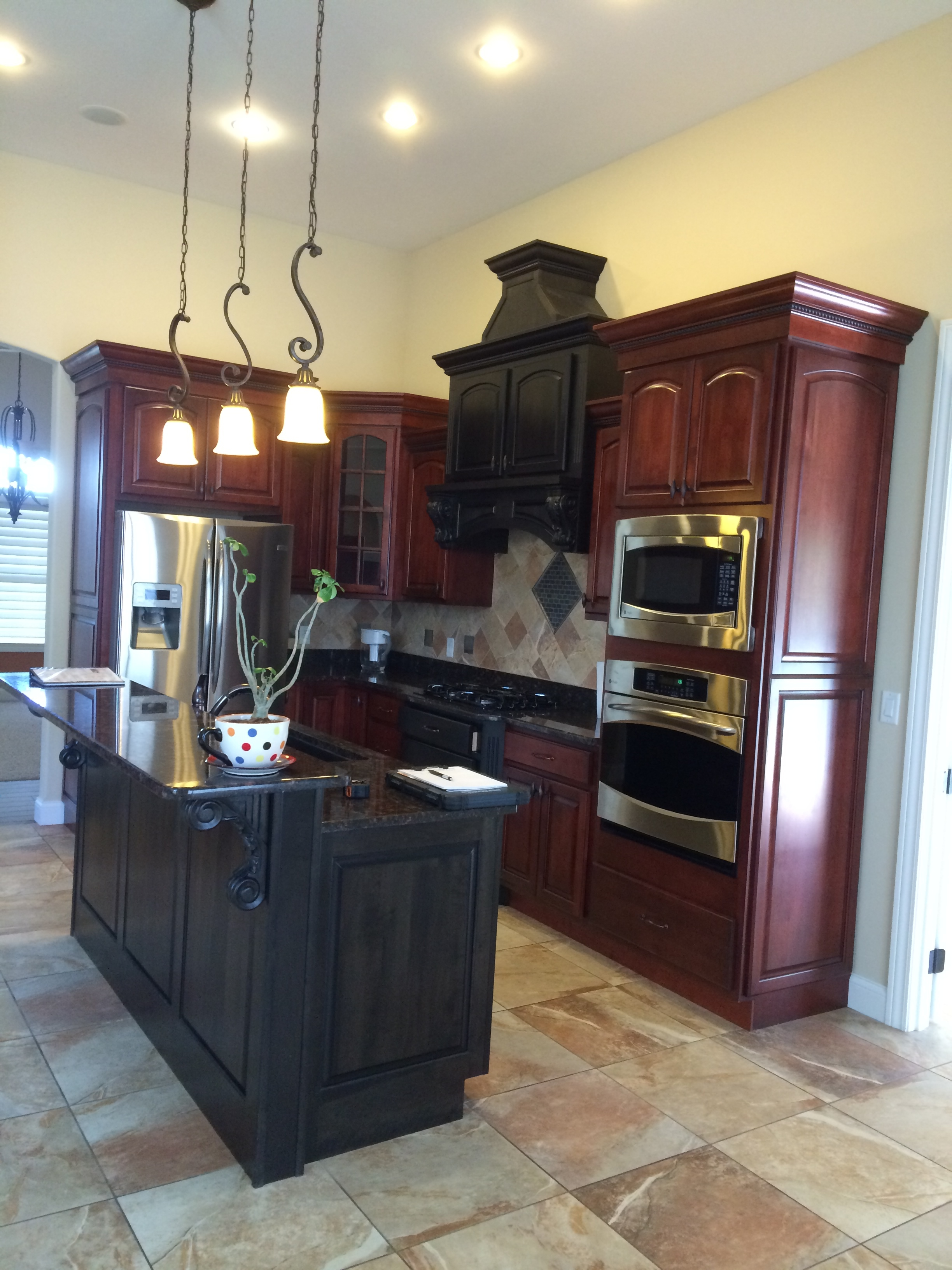 Cherry Cabinets with Black Island