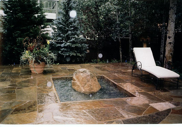 Copy of Fountain boulder on patio.jpg