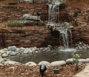 Flagstone-retainer-wall-spills-patio-wat