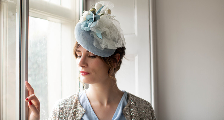 SOFT BABY BLUE PERCH HAT WITH SILK & LEATHER FLOWERS AND A SMATTERING OF TULLE