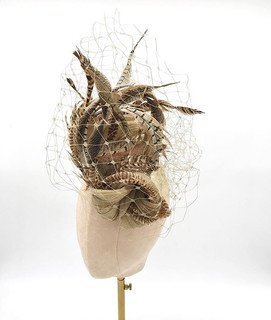 Sculptural silk & feather headpiece with