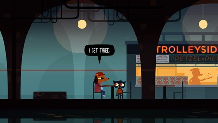 """Screenshot from the game Night in the Woods. Two characters are conversing at a table next to a pretzel stand in an underground out of service train station. One is older, and sitting down facing the short cat-like protagonist of the game, and saying to them """"I get tired."""""""