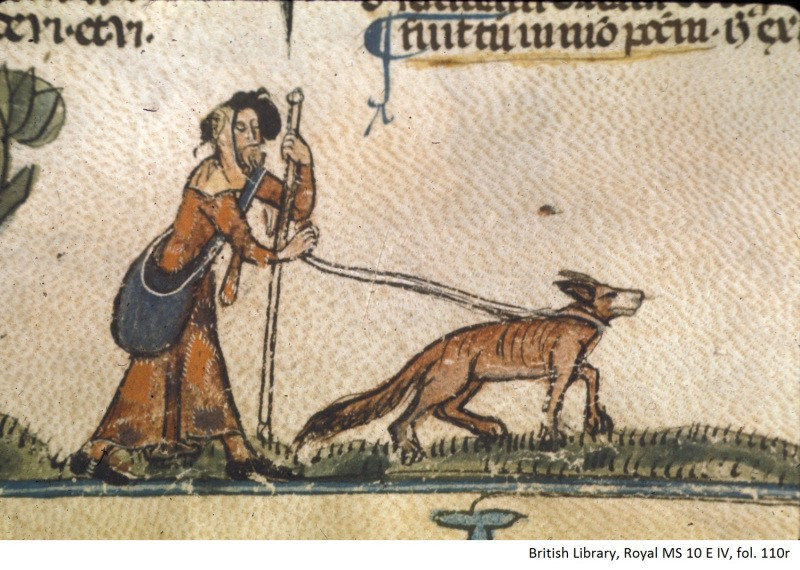 picture of blind man being led by a dog