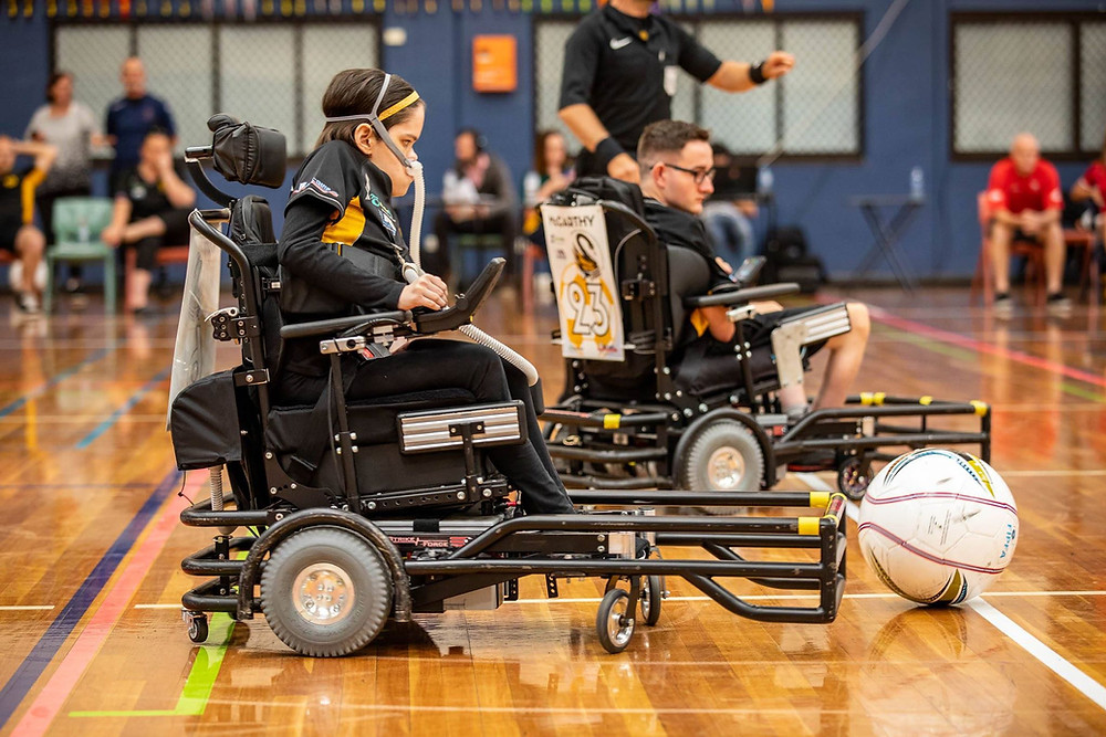young woman in modified wheelchair playing sport