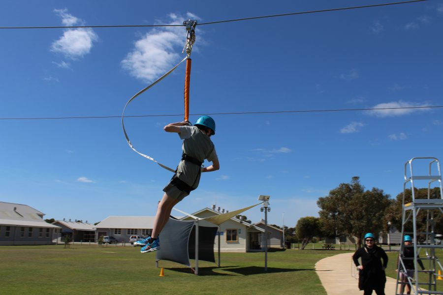 Boy on flying fox at camp