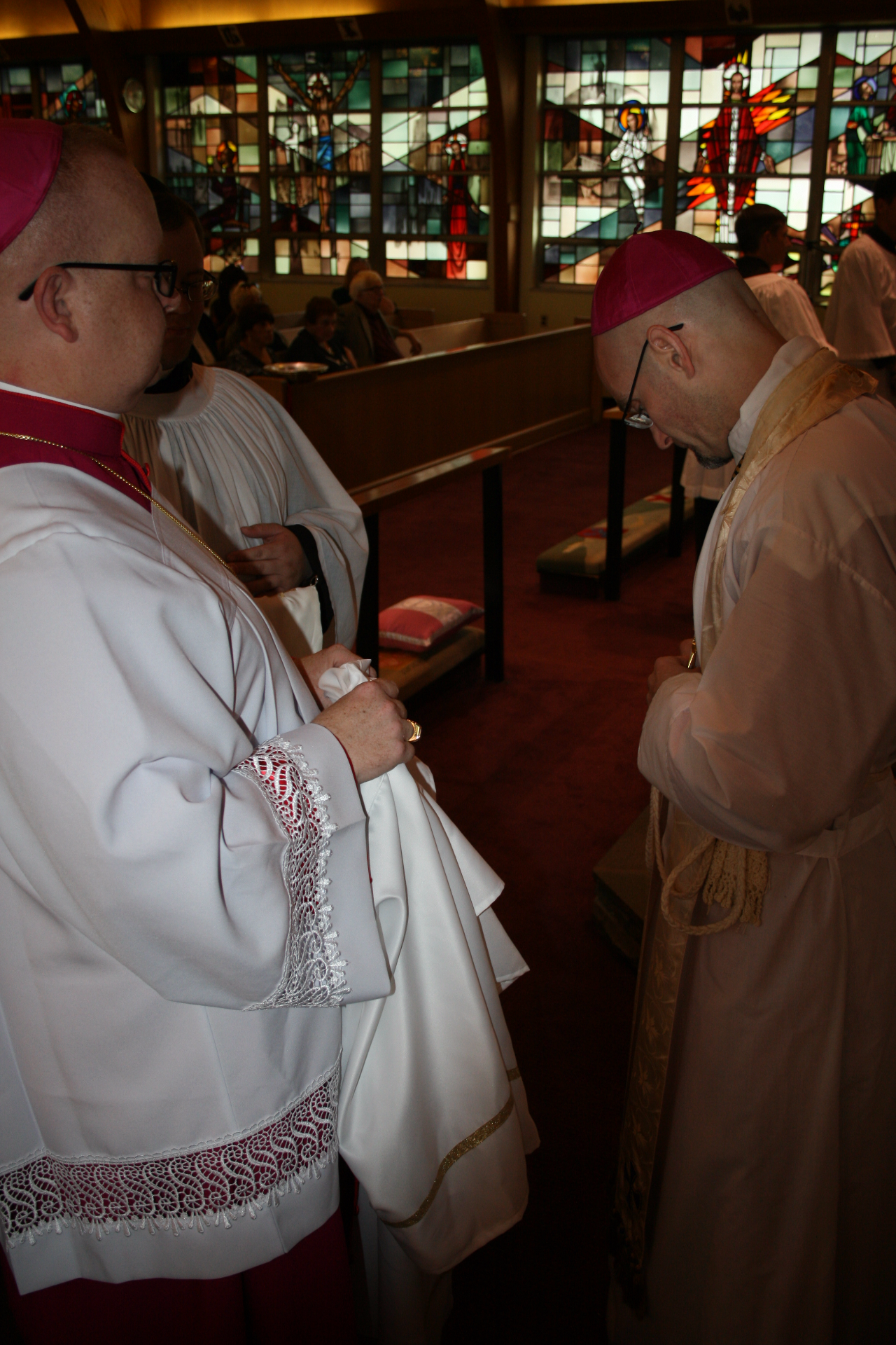 Bishop elect ties the cincture