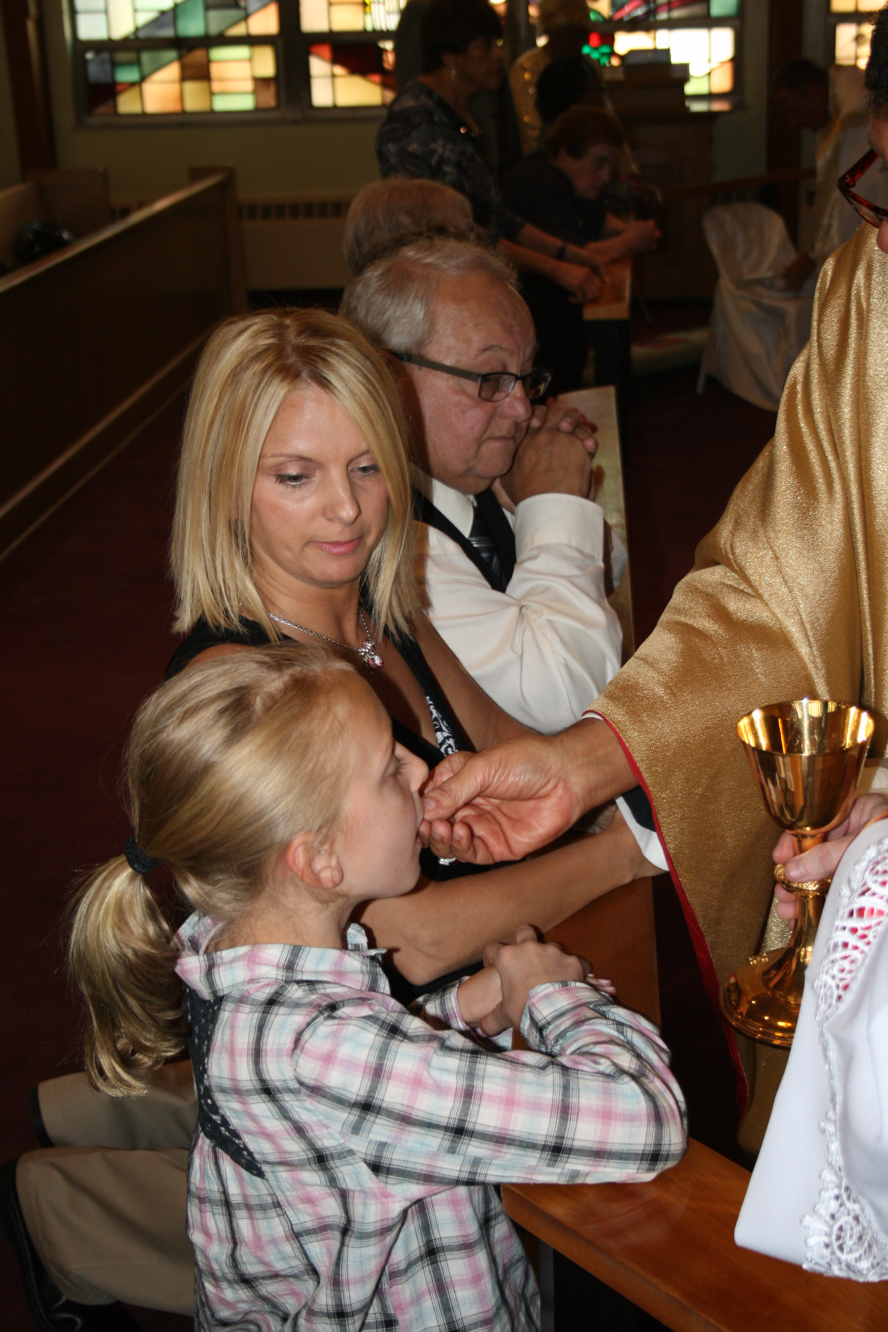 Bp. Joseph niece received Communion