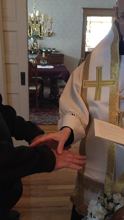 Anointing the hands of the Catechumen
