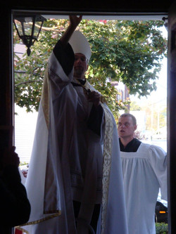 Bishop Joseph anointing the entance