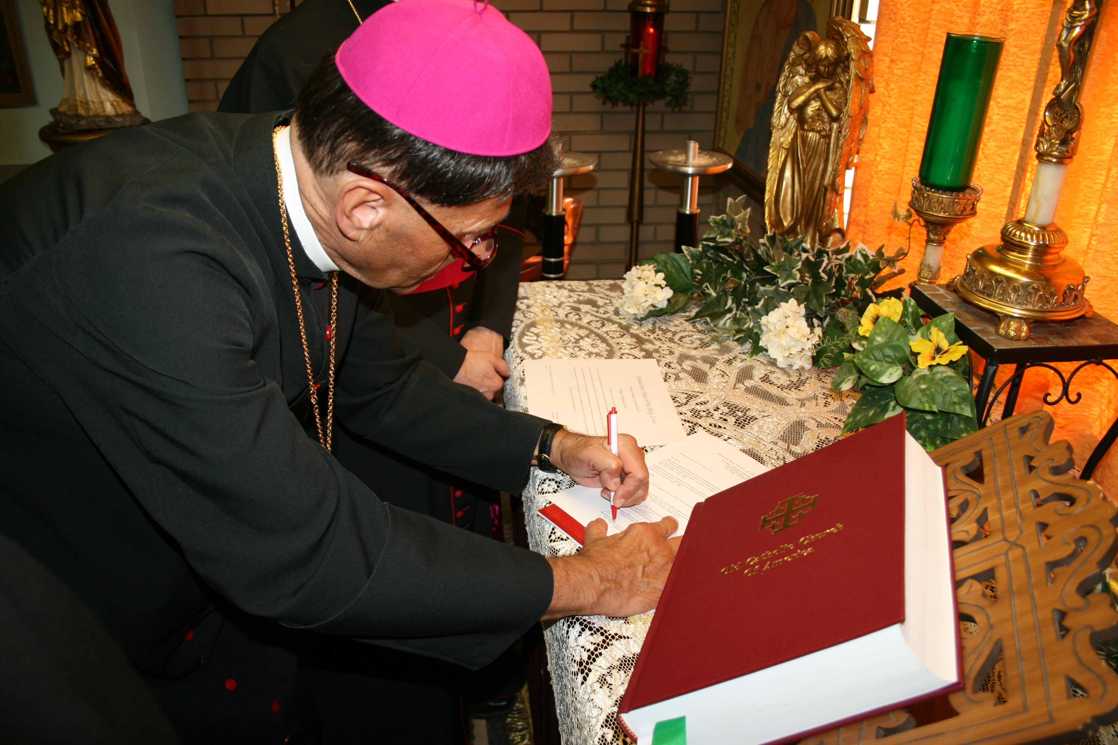 Bishop Victor signing vows
