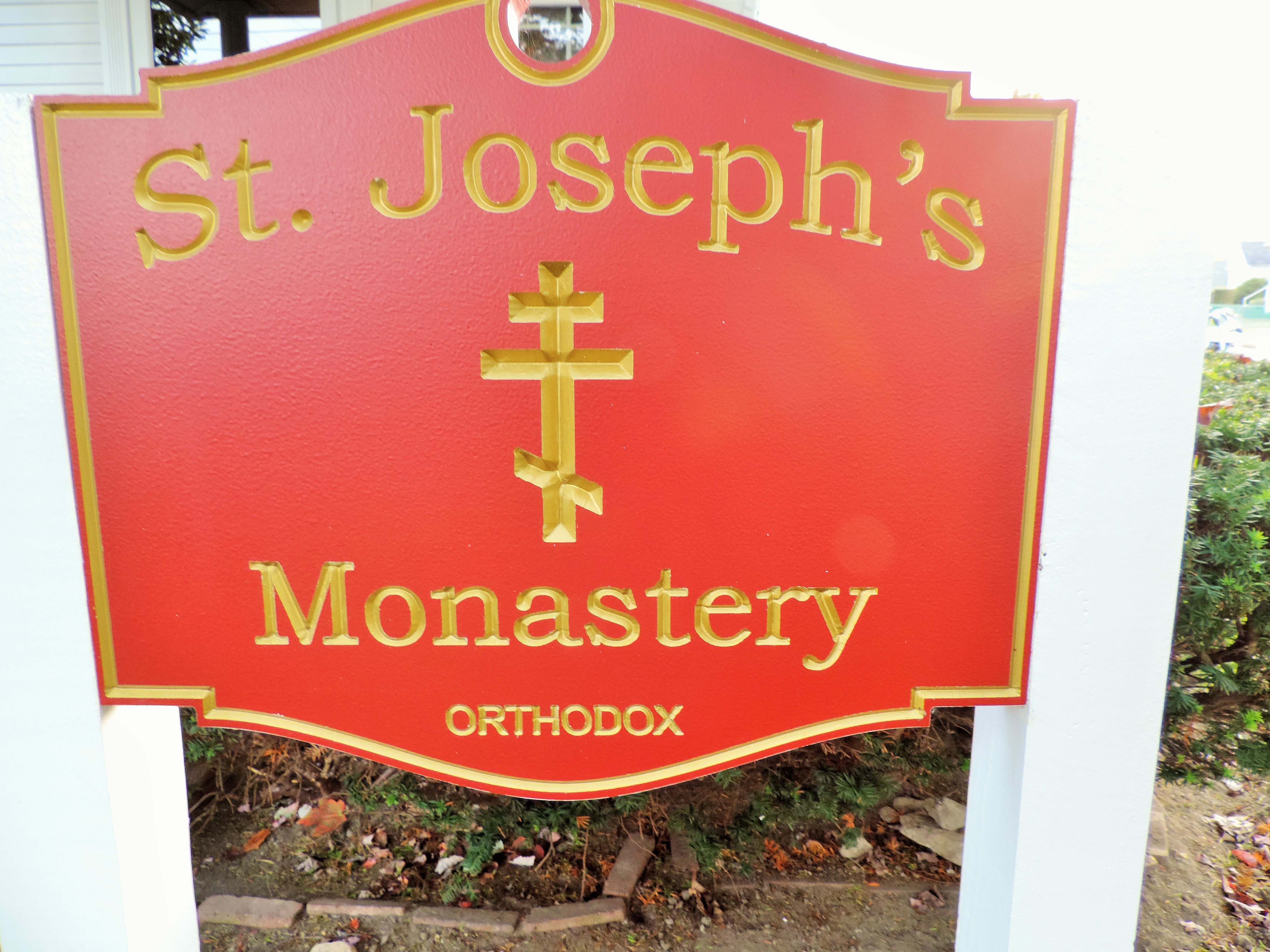 The Monastery sign