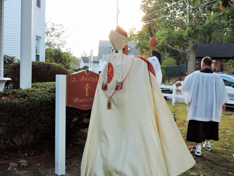 Bishop Victor blessing...