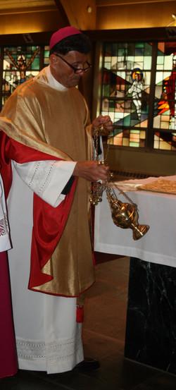 Bishop Victor incensing