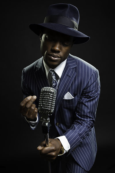 Black man with blue striped suit and blu