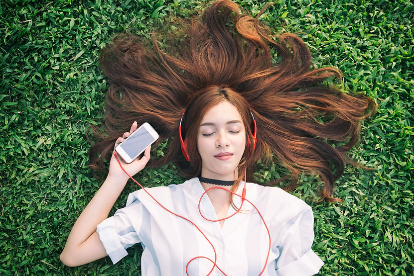 Indian girl listening to music streaming